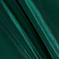 Poly Charmeuse Satin Hunter Green from @fabricdotcom  This lightweight charmeuse satin fabric is ultra smooth and has a fluid drape. Charmeuse satin is perfect for blouses, dresses and skirts - especially on the bias. It's also perfect for lingerie and binding baby blankets!
