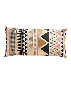 Janey Pillow Want to make your sofa sofabulous? Add a geometric throw pillow with black, cream, pale pink, and metallic details. 23 by 11 inches. To buy: $40, cb2.com.