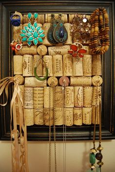I've been looking at both jewelry holders and wine cork boards - never thought of combining them. This is perfect! With a really fun frame...