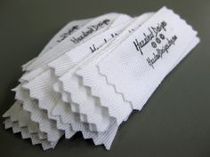 Pear Tree Stitching: handmade labels: rubber stamp, permanent ink, twill tape, pinking shears.