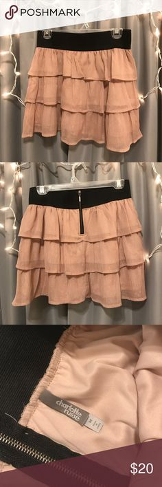 Charlotte Russe nude pink ruffle skirt Nude pink ruffle skirt with a half zipper in the back. Slightly sparkly. Stretchy black waistband. Super cute! Message me with any questions! Charlotte Russe Skirts Mini