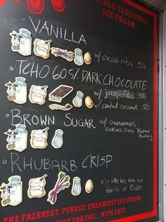 Ice cream shop blackboard with ingredients listed.