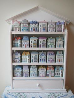 This sweet vintage collection of the Lenox Spice Village features 24 different miniature houses that are sculptured in fine porcelain. The roofs of the houses come off for storing spices. They are in perfect condition with the original boxes. The hardwood spice rack has a bottom drawer for recipe cards. It can be displayed on... View Article