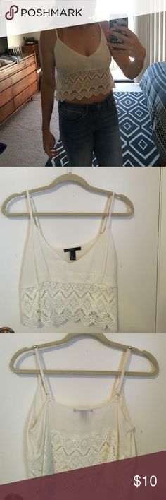 Forever 21 Cream Colored Lace Detail Crop Top Spaghetti strap cream colored crop top with lace detail on bottom. Adjustable straps, front v neckline. Never worn, brand new! Size M, No trades Forever 21 Tops Crop Tops
