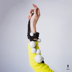 Long necklace made of leather, porcelain ball and silver from SU-MIN collection.  Bracelet from SU-MIN collection.