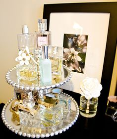 Two tier cake stand turned perfume stand. Could also use for jewelry and everyday makeup