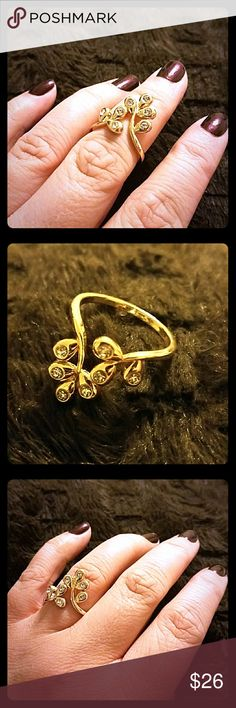Leaf ring Faux gold leaf filligree ring with rhinestones. Works beautifully as a midi ring too as shown. Available in size 6 or 9. Model is a size 9 on the middle finger (size 6 is midi fit on the size 9 finger) Jewelry Rings