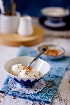 A creamy Coconut Vanilla Ice Cream prepared without any ice cream machine and topped with crunchy coconut flakes.