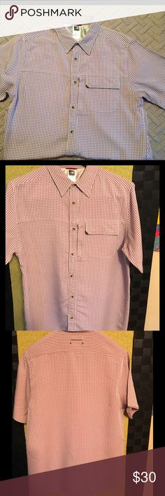 Men's Short Sleeve w/2 front pockets in Front Colors are grey and red small Checker shirt wrinkle free material cotton and polyester blend. Has hidden front zipper side pocket and a front pocket. The North Face Shirts
