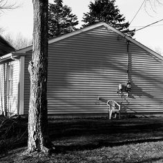 Portland, Maine  Seems like a lovely place to sit outside for an afternoon by yourself. I also love the shadows cast on the side of this windowless side of a house.  #builtlandscape - #Portland #Maine #roadside #exploreusa  #exploreAmerica #bnw #blackandwhite  #bw_society #bnw_captures #bnw_usa #scenesofme #scenesofnewengland #visitme #newenglandphotography #exploreme #daylight