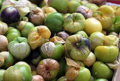 """In Spanish, tomatillos are referred to as the tomate verdes, or """"green tomatoes,"""" but if you're expecting the flavor of a tomato, guess again. Fruit And Veg, Fruits And Veggies, Vegetables, Tomato Salad Recipes, Sweet Watermelon, Popsugar Food, Juicy Fruit, In Season Produce, Green Tomatoes"""