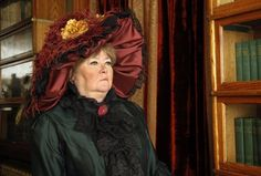 Janet Kalstrom poses in character as famous Titanic survivor Margaret 'Molly' Brown