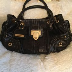 SALEJUICY COUTURE ALL LEATHER Awesome all leather black juicy Couture purse with gold accents. Snap closure, inside pocket, great condition Great buy  Juicy Couture Bags Satchels