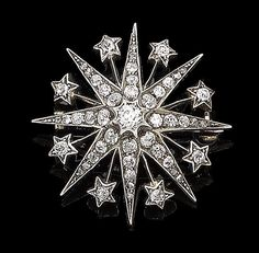 A diamond star brooch/pendant, circa 1880. The eight-rayed star set with graduating old brilliant and rose-cut diamonds, each ray interspersed by a spoke terminating in a cushion-shaped diamond star, mounted in silver and gold