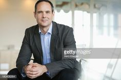 Stock-Foto : Portrait of confident businessman sitting in office