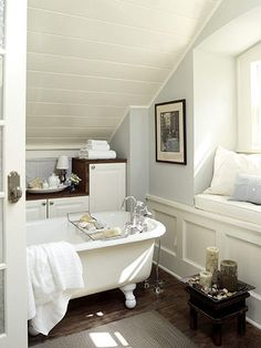 """I am amazed at how free this bathroom is. There is a vibe of, """"hey, all of my friends! come relax and chat with me while I bathe"""". Can't go wrong with dark brown wooden accents either."""