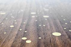 star map table w/ brass inlay on a single walnut slab (detail) • asher israelow