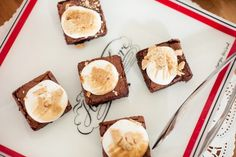 """Brownies topped with marshmallow fluff and graham cracker crumbs (""""S'mores brownies"""")"""