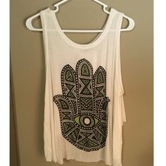 Hamsa tank with open back White tank with black and green hamsa on front. Back is open. Looks good with denim cut off shorts. Only worn a few times. Urban Outfitters Tops