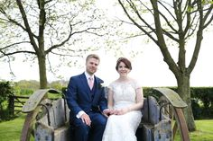 bride and groom on an old tractor in suffolk wedding