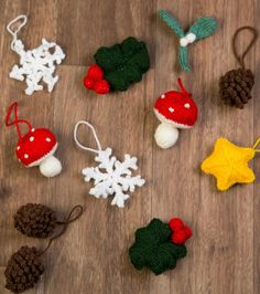 Free Until Dec. 26 Winter Woodland Garland Knitting Pattern - The pattern includes a pine cone, mistletoe, holly leaf, snowflake, star and toadstool. Each little item is strung on a knitted garland using buttons. Designed by Sue Stratford.