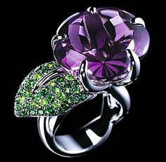 "The ""flower"" is made of a large amethyst.  The ""leaf"" is composed of tsavorites.   by Chanel"