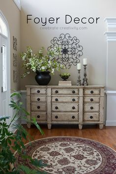 Oct 2016 - Add beauty and impact to your foyer space with a little credenza decor. Simple pieces add color, interest and character to a freshly-painted cabinet. Credenza Decor, Cabinet Decor, Entryway Cabinet, Sideboard, Small Front Entryways, Front Entryway Decor, Foyer Table Decor, Entrance Foyer, Foyer Furniture