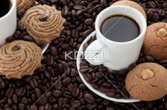 coffee and coffee beans with cookies - Coffee and coffee beans with cookies in a macro image