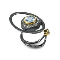Ring | Gabriel Kabirski.  Sterling silver with rhodium and gold plating combined with blue topaz, fianite and chrysolite stones.