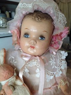 Antique vintage composition baby doll w/ flirty sleep eyes - pink chiffon outfit
