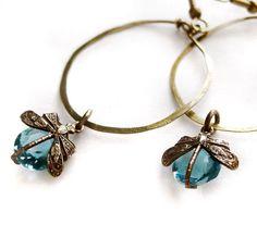 Hammered hoop earrings with Victorian dragonflies encasing aquamarine blue vintage glass jewels