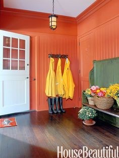 """""""It's new and a little different — not quite orange and not quite red. More of a persimmon. It feels warm and inviting when you come in from the cold, and if there's a little mess in the mudroom, you don't notice because you're so surprised by this rich, exciting color. We even painted the moldings and doors to make it more intense."""" -John Barman  Charlotte's Locks 268, Farrow & Ball"""