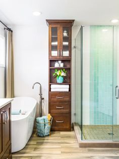 "Designer Harmony Wells chose a tall cabinet to solve several problems in her clients' small bath. ""Because the space only had 8-foot-high ceilings, we wanted to draw the eye up. The floor-to-ceiling custom linen cabinet makes the room feel larger and lighter,"" she says. Wells designed the piece with an open-and-closed combination of storage. ""This makes the unit less busy, visually, and keeps the overall scale on the smaller side, so it doesn't compete with the shower."""