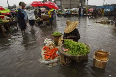 Hurricane #Sandy passed to the west of #Haiti on 25 October, causing heavy rains and strong winds, flooding homes and overflowing rivers. In this picture, a woman is selling produce at a flooded market place in Port-au-Prince.  UN Photo/Logan Abassi.