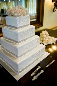 Square Wedding Cake- would love this with gold flowers and black ribbon or bling trim