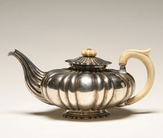 Austro-Hungarian silver teapot; ribbed body and spout with gold wash on interior, also bone handle and lift. Marks for Vienna, 1857
