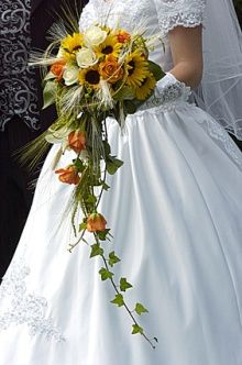 A sunflower spray   is lovely and just look at the colors. #Weddings #WeddingFlowers