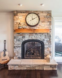 Cultured stone living room transitional with wood mantel raised hearth fireplace wood mantel Fireplace Hearth Stone, Stone Fireplace Designs, Stacked Stone Fireplaces, Rustic Fireplaces, Rustic Mantel, Outdoor Fireplaces, Rustic Wood, Brass Fireplace Makeover, Fireplace Redo