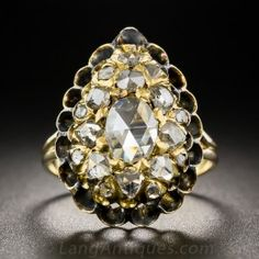 Something delightfully different. A rare and wonderful early-Victorian bauble, aglitter with multi-shaped rose-cut diamonds arrayed over a pear shaped dome and bordered with an open scallop design. 1.35 carats total diamond weight.Lightly handcrafted in 14K gold and re-shanked in 18K. 13/16 inch long, currently ring size 5.