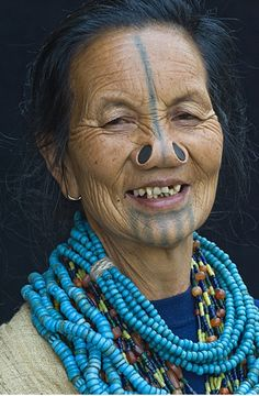 *Apatani woman. India <3  Their villages were constantly raided by neighboring tribes, and the women kidnapped.To make themselves unattractive to the other tribes, Apatani women began wearing these hideous nose plugs and tattooing their faces with a horizontal line from the forehead to the tip of the nose, and five lines on their chins. Let's face it, that turns off any raider in search of beautiful women to have his way with.
