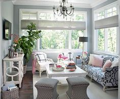 Pretty Meets Practical - love the white, pink and navy. And I see a fiddle leaf fig! More living room decorating ideas: http://www.bhg.com/decorating/decorating-photos/living-room/