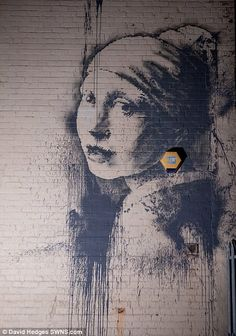 Banksy's version of Girl With A Pearl Earring appears on Bristol wall | Daily Mail Online