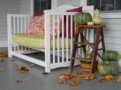 Baby crib turned front porch daybed