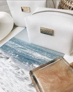 White medusa cosmetics bag from April Malmsteen