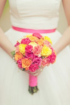Orange, pink, and yellow wedding bouquet.  If we ever do it again, these flowers would look great with a white lilly dress!