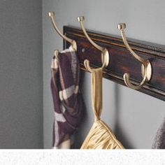 Don't compromise style for storage. This elegantly designed Liberty Hardware Galena Hook Rail from the Luxe Collection adds a beautiful decoration detail to your entryway with a pop of gold sheen and rich wooden tones. Shop the rest of the Luxe Collection online and see how you can curate a classic style in your home.