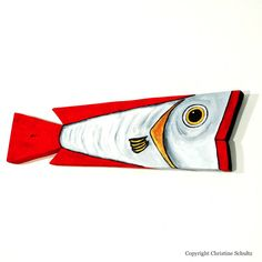 This wood fish was handmade by Marc Deloach from cypress he salvaged in the Mississippi Delta. I, Christine Schultz, handpainted it in red and white