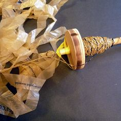 """Spinning Plarn    1"""" continuous strips of plarn spun on a handmade drop spindle"""