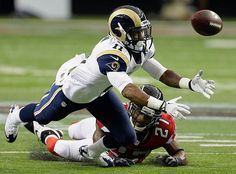 Louis Rams wide receiver Tavon Austin vies for a thrown ball against Atlanta Falcons cornerback Robert McClain during the first half of an NFL football game, Sunday, Sept. in Atlanta. Falcons Football, Nfl Football Games, Football Helmets, Fantasy Football Sleepers, Gladiator Games, Nfl Photos, Superbowl Champions, St Louis Rams, Sports Stars