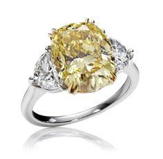 Winston designers reinterpret the theme in a brilliant Yellow Diamond Ring.